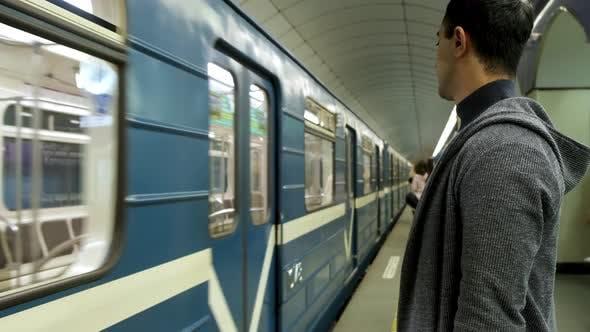 Man entering a subway train