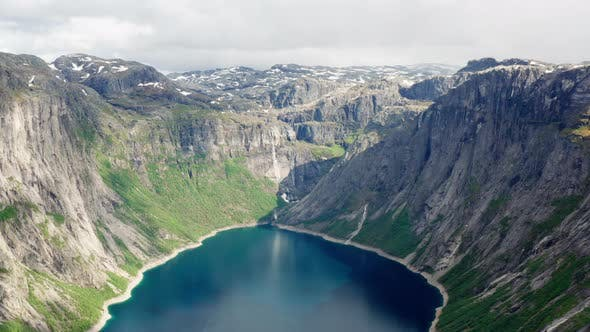 Thumbnail for Drone Flying Backward To Reveal a Magnificent View of the Ringedalsvatnet Lake