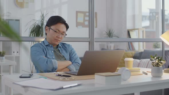 Thumbnail for Asian Businessman Falling asleep at Workplace in Office