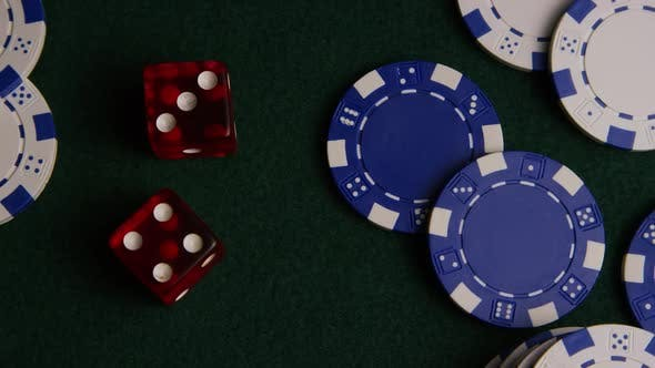 Rotating shot of poker cards and poker chips on a green felt surface - POKER 019