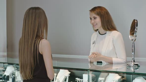 Thumbnail for Woman Talking with Seller in Jewelry Boutique