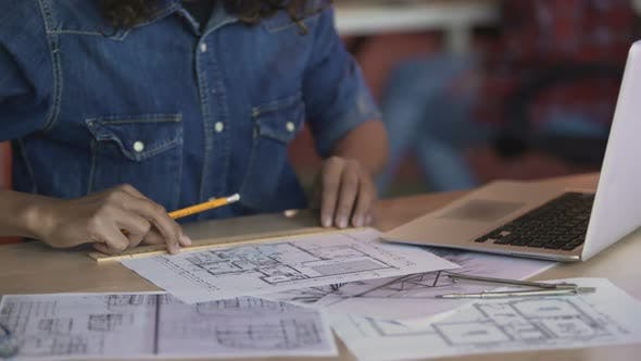 Thumbnail for Biracial Female Designer Working on Apartment Layout Plan, Drawing Line on Paper