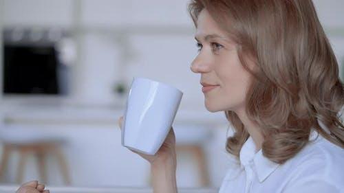 Female Enjoy Drink Holding Mug