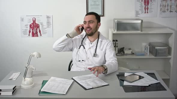 Thumbnail for Friendly Doctor Talking By Smartphone with Somebody