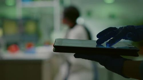 Scientist Researcher Doctor Analyzing Genetic Mutation Test Using Tablet