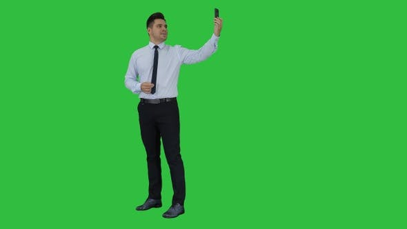 Thumbnail for Happy young handsome businessman recording vlog or making