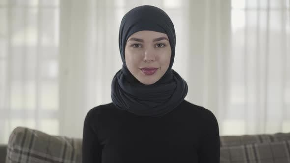 Cover Image for Close Up Portrait of Successful Confident Young Muslim Business Woman Looking at Camera Smiling