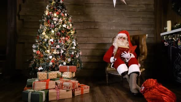 Thumbnail for Santa Claus Read Book Near X-mas Tree