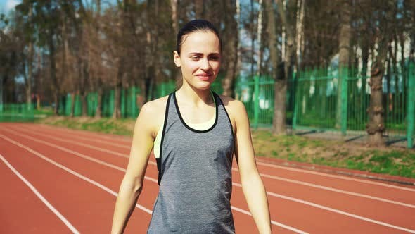 Thumbnail for Sport reaction video Athletes at starting position preparing for run at the stadium