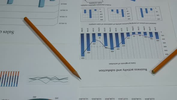 Thumbnail for Business Graphs Of A Sales Company On A Desk In A Modern Office