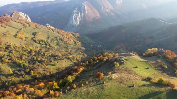 Thumbnail for Flying Above Colorful Autumn Countryside Forest in the Mountains
