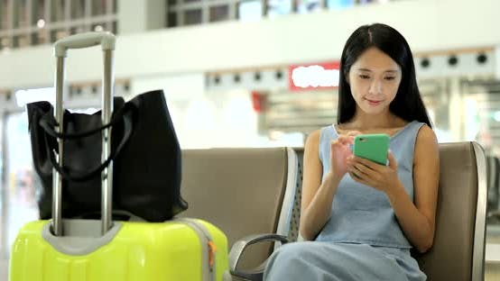 Thumbnail for Woman Using Cellphone in Airport