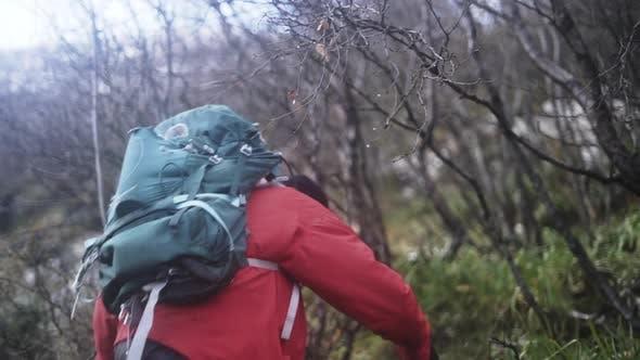 Hiker Walking Up Steep Hill