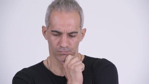 Serious Persian Man Thinking Against White Background