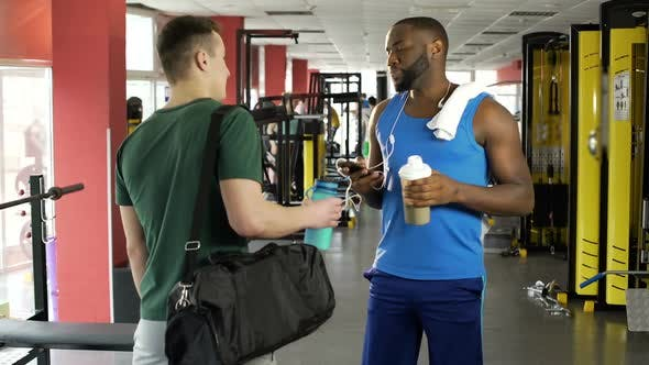 Thumbnail for Two Athletic Men Talking at Fitness Club, Sportsmen Drinking Protein Cocktails