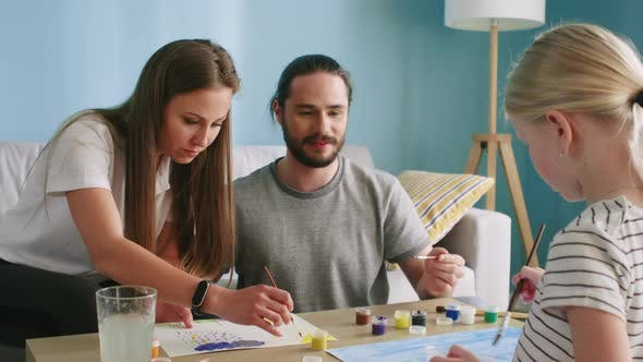 Thumbnail for Couple and Small Girl Are Drawing Colorful Pictures
