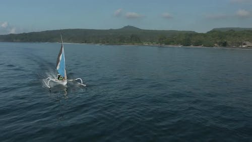 Aerial View Of Boat With Sail In Ocean In Bali, Indonesia