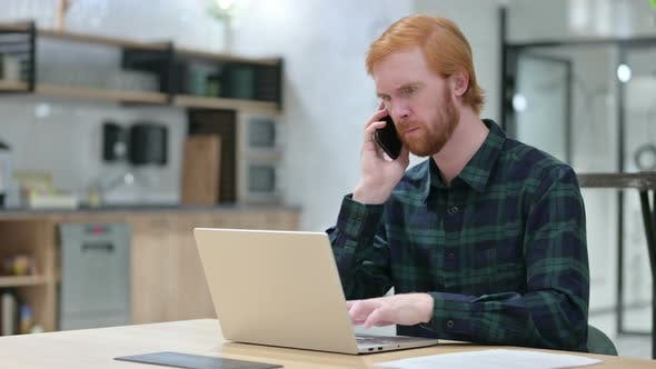 Thumbnail for Beard Redhead Man with Laptop Talking on Smartphone