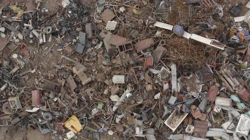 Scrapyard with Rusty Metal Scrap Pile