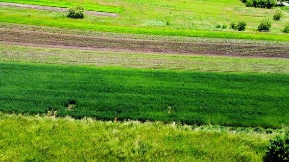 Aerial drone view of a flying over the rural agricultural landscape.