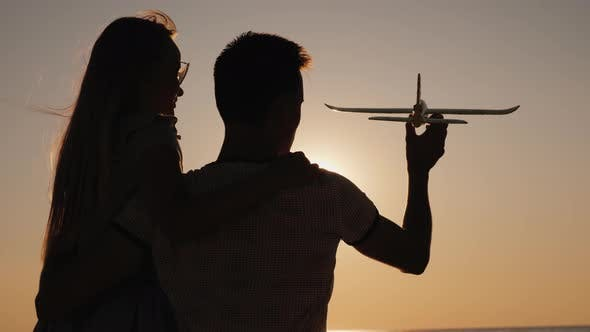 Thumbnail for Man and Child Play with a Toy Airplane