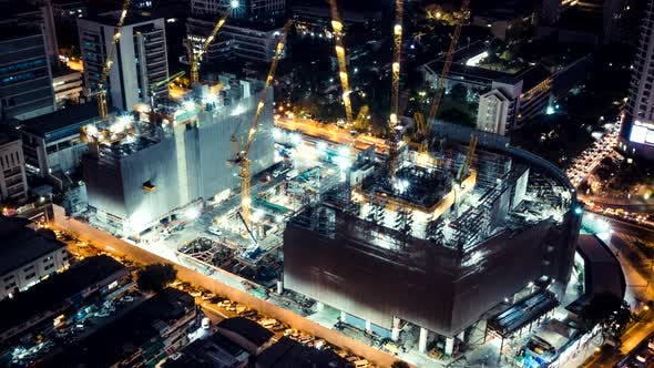 Thumbnail for Time-Lapse of Under Construction Building Site at Night with Car Traffic Transportation in The City
