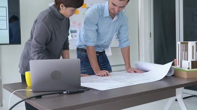 Business man and woman with laptop