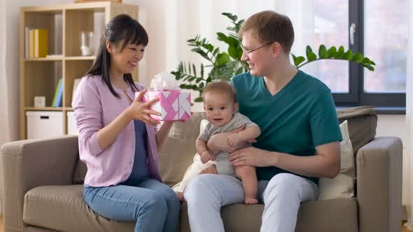 Thumbnail for Happy Family with Gift and Baby Boy at Home 19