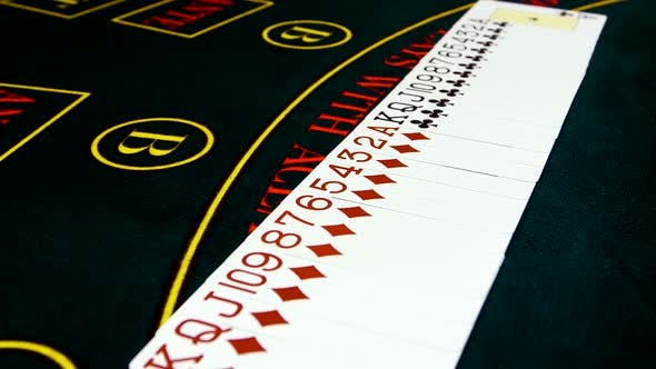 Thumbnail for Playing Cards Are Spread Out on Green Surface Poker Table