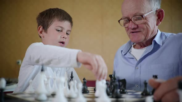 Thumbnail for Board Games, an Elderly Man in Glasses for Vision and a Happy Cute Male Child Have Fun Together