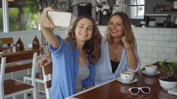 Thumbnail for Lesbian Couple Dating in Cafe. Two Beautiful Women Taking Selfie Photo in Slow Motion