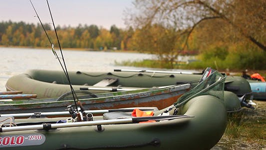 Thumbnail for Fishing Rubber Boats With Rods On Lake Coast