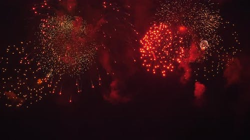 Bright Beautiful Fireworks in the City in the Night Sky
