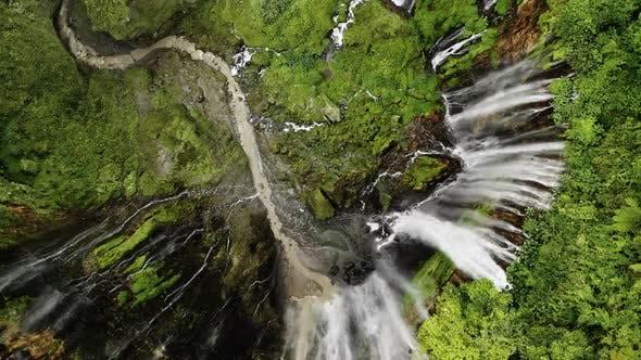 Drone Directly Over Edge Of Tumpak Sewu Waterfalls