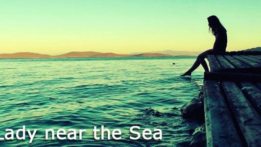 Lady Near The Sea