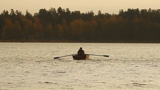 Thumbnail for Rowing Fisherman On Wooden Boat