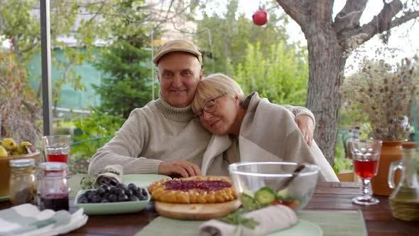 Thumbnail for Elderly Loving Couple Hugging and Posing in Garden