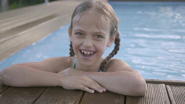 Thumbnail for Portrait Cute Funny Girl with Pigtails Laughing Looking in the Camera