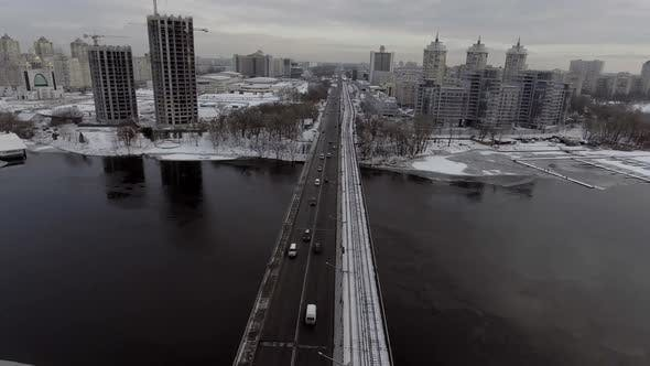 Thumbnail for City Traffic on the Bridge, It's Snowing