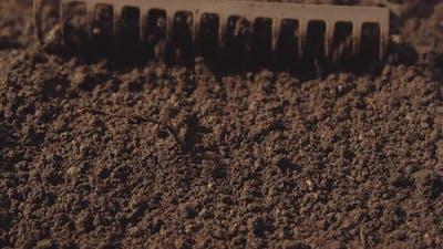 Soil Being Raked In Garden