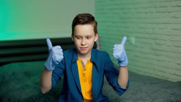 Thumbnail for Boy wears medical rubber gloves