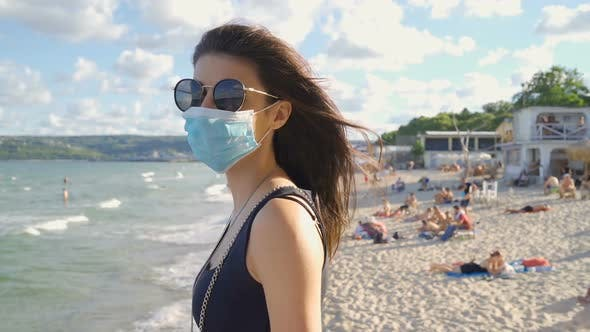 Thumbnail for Woman Wearing Protective Mask in the Public. Traveling During Pandemic COVID-19