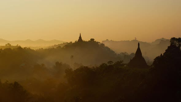 Thumbnail for Time Lapse of morning fog and smoke moving past ancient temples in Myanmar