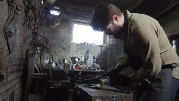 Thumbnail for Handsome Caucasian Blacksmith Working in Smithy