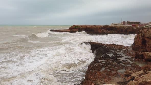 Thumbnail for Ocean Water Breaks on Rocks. Strong Frothy Waves of Ocean Roll on Rocky Shore of Island