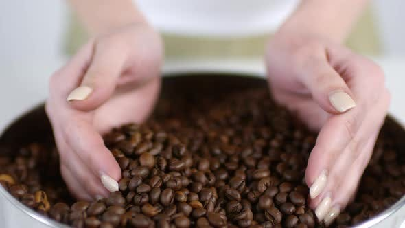Thumbnail for Woman Taking Handful of Coffee Beans