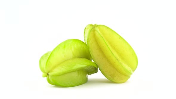 Thumbnail for Two Whole Carambola Fruits Are Rotating on the Turntable Isolated on the White Background