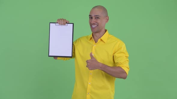Thumbnail for Happy Handsome Bald Businessman Showing Clipboard and Giving Thumbs Up