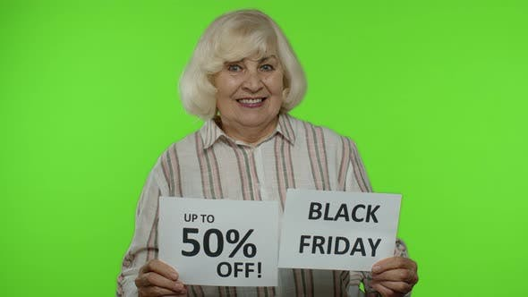 Thumbnail for Grandmother Showing Black Friday and Up To 50 Percent Off Shopping Price Discount Advertisement