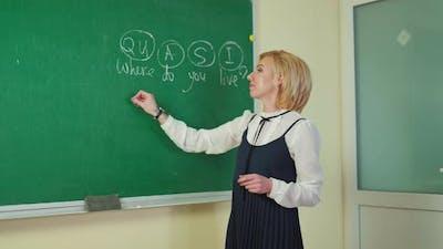 Teacher near the blackboard